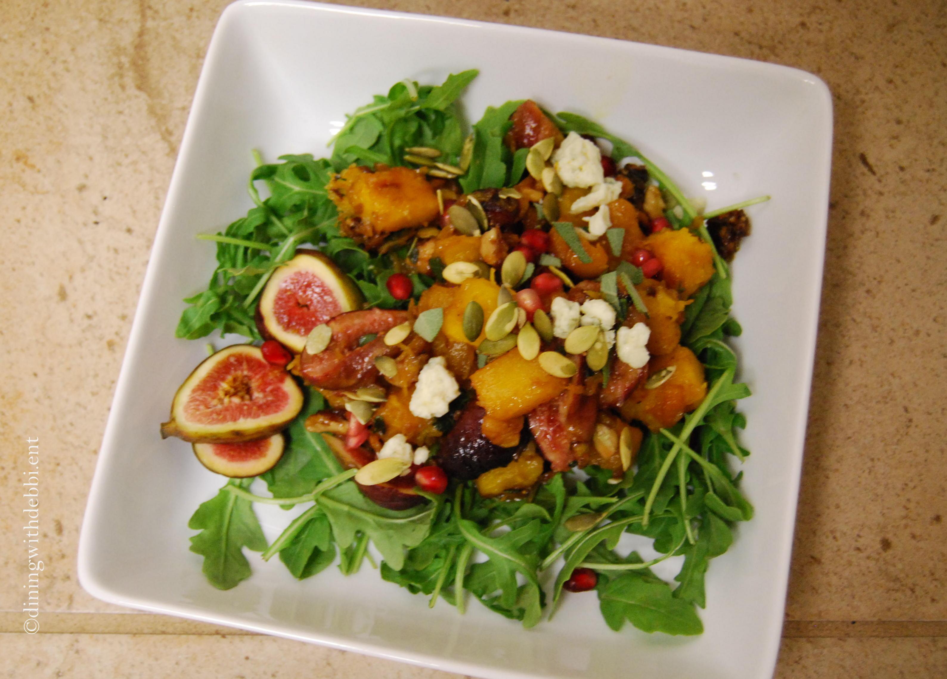 roasted pumpkin fig pomegranate and arugula salad via diningwithdebbie.net